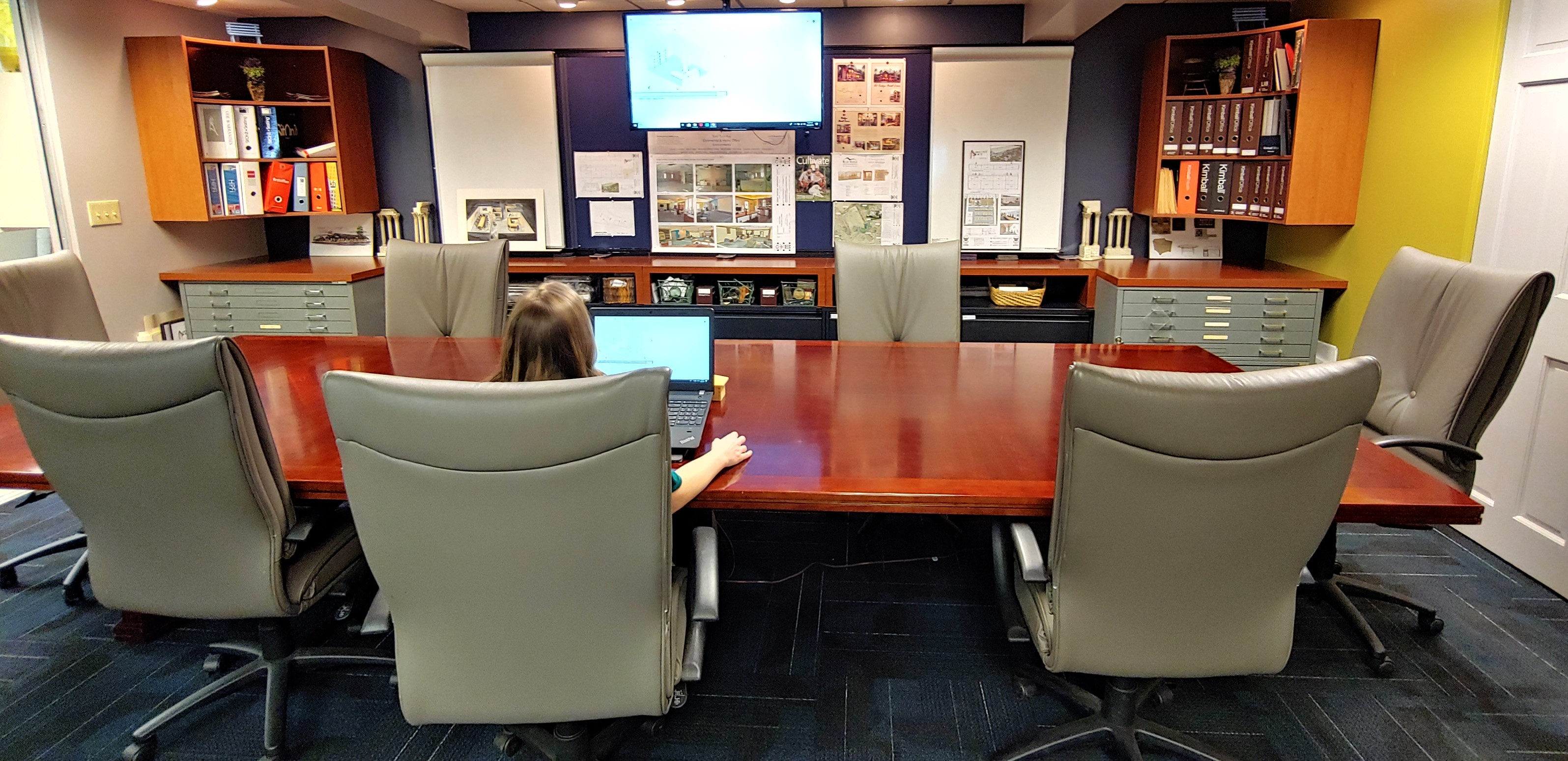 industry professionals guide clients in office furniture showroom